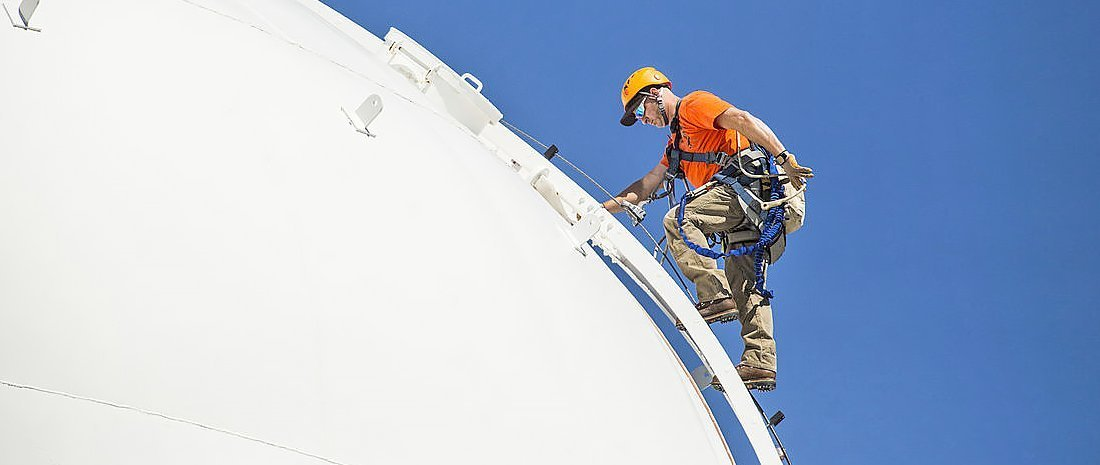 Tower Climber Performs Field Site Maintenance