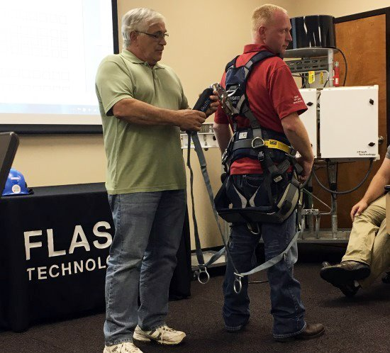 Safety Stand Down tower climber safety harness demonstration