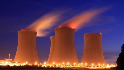 Hyperbolic cooling towers are marked by red or white tower lighting systems