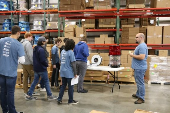 Production supervisor, Jacob, explains the xenon and LED obstruction light manufacturing process to students on Manufacturing Day 2018