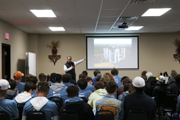Flash VP, Pete, provides an introduction to aviation obstruction lighting for students from Fariview High School for Manufacturing Day 2018.