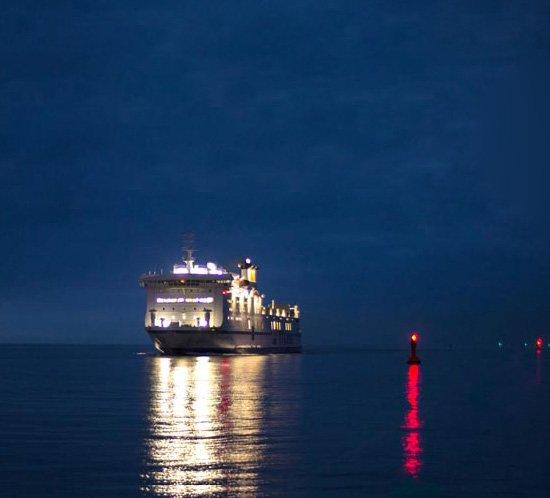 A ship passes a marine lantern