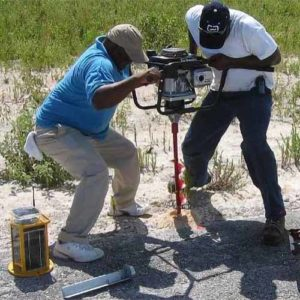 Installing A704 runway edge lights at Arthur's Town Airport in the Bahamas