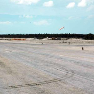 A704 runway threshold lights and aviation windsock at Duncan Town Airport in the Bahamas