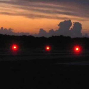 Red runway lights at Farmer's Cay Airport in the Bahamas