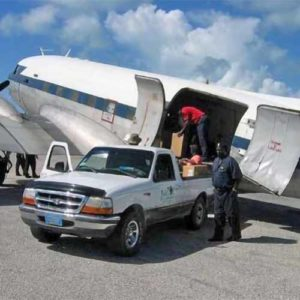 Unloading solar airfield lights at Sandy Point Airport in the Bahamas