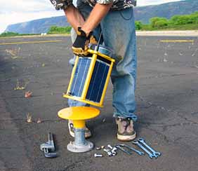 Solar airfield and obstruction lights are rapidly deployable and portable
