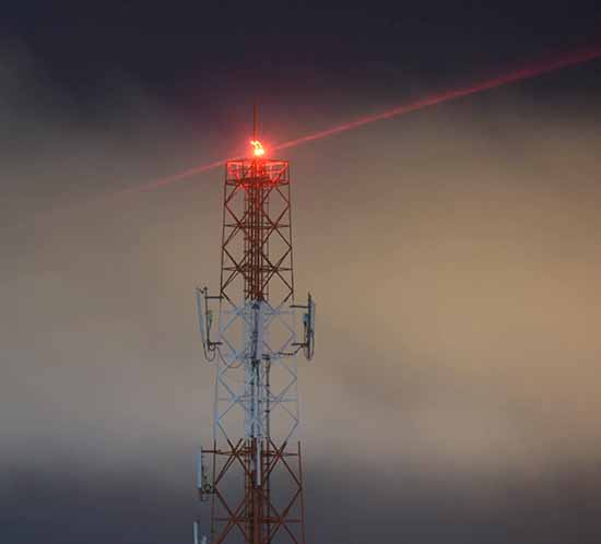 medium intensity flashing red obstruction light on tower