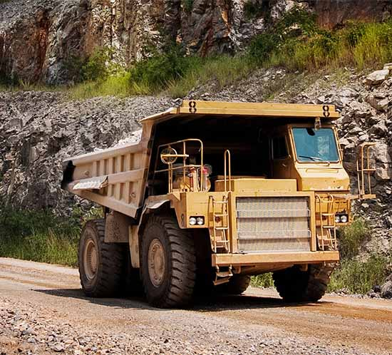 mining truck driving on a haul road