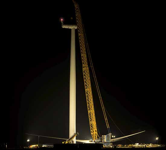 A wind turbine under construction should be lit by a red obstruction light at night