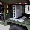The controller and power storage visible inside an open portable airfield lighting trailer (PALT)