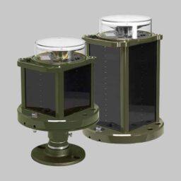 A compact and a standard sized A704 runway lights with olive drab chassis