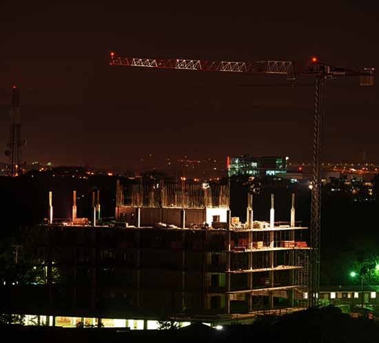 Tower cranes are marked with paint for day and red/infrared lights for night
